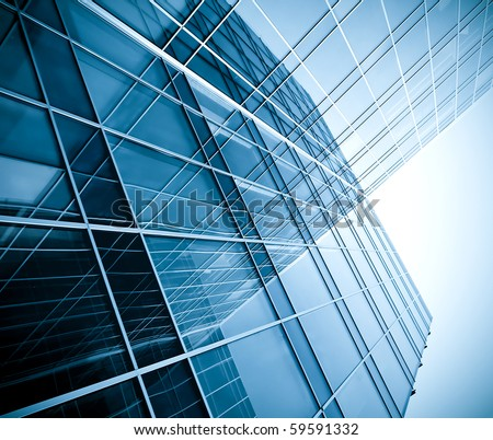 blue glass wall of skyscraper - stock photo