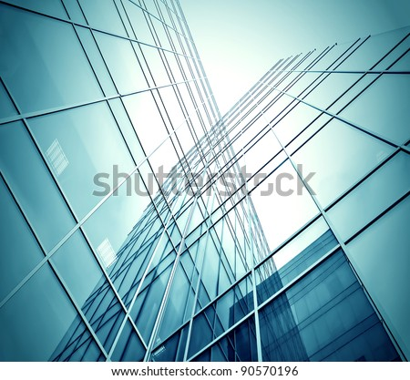 blue glass wall of skyscraper