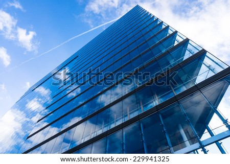 blue glass wall of skyscraper.  Buildings abstract - stock photo