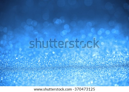 Blue glitter surface with blue light bokeh - It can be used for background for special occasions promotion campaign or product display - stock photo
