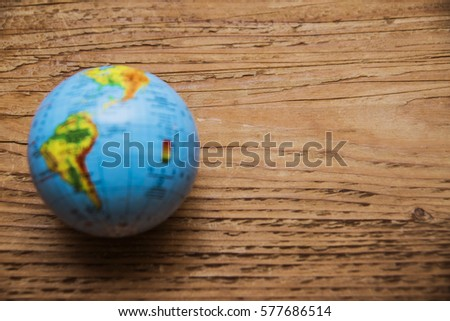 Blue globe map lie on wooden stock photo royalty free 577686514 blue globe map lie on wooden table save earth world globe ball for educational gumiabroncs Images