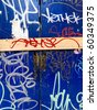 Blue graffiti on abandoned boarded up building - stock photo
