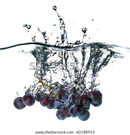 blue grape dropped into water with splash isolated on white - stock photo