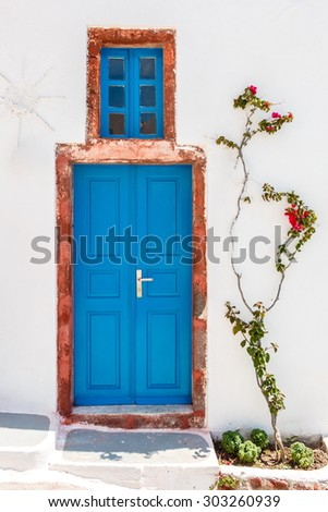 Blue Greek house door in Santorini - stock photo