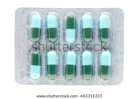 blue green antibiotic pills gelatin capsule in blister pack - stock photo