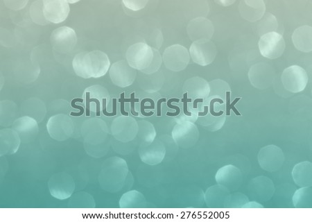 Blue green blurred lights. Glittering abstract background - stock photo
