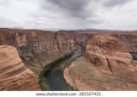 Blue Green Colorado River winds through the Grand Canyon - stock photo