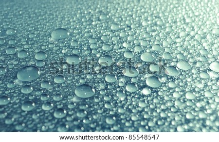 Blue-green water drops as background - stock photo