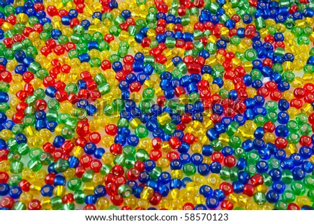 Blue , green, yellow & red beads close up. - stock photo