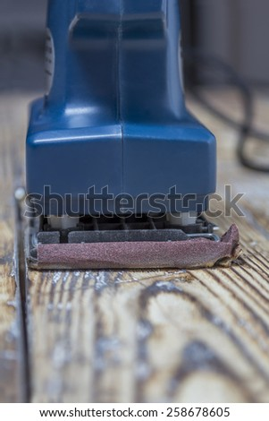 blue grinding machine on rustic wooden surface - stock photo