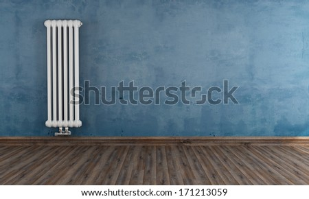 Blue grunge room with classic vertical radiator on wall - rendering