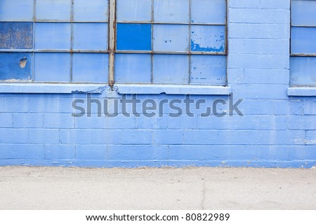 blue grungy wall with windows background - stock photo