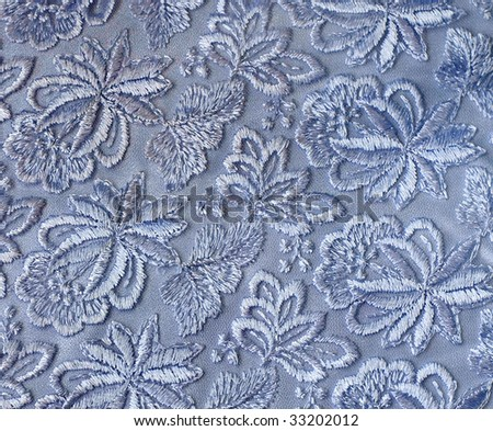Blue guipure, embroidery on cloth for wedding dress, texture - stock photo