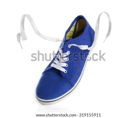 Blue gumshoe isolated on white - stock photo