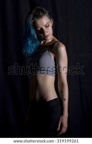 Blue haired girl pose in studio