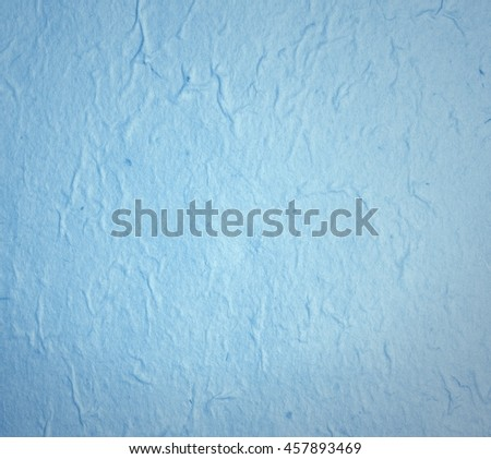Blue hand made paper for texture or background - stock photo