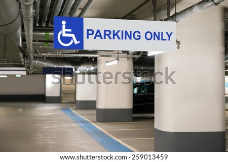 Blue Handicap Parking Only Sign For Disabled Drivers - stock photo