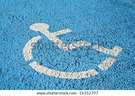 Blue handicap parking or wheelchair accessible sign in parking - stock photo