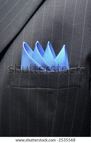 Blue handkerchief inside a pinstriped suit breast pocket - stock photo