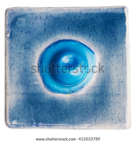 Blue handmade glazed ceramic tile with bubble in middle isolated on white - stock photo