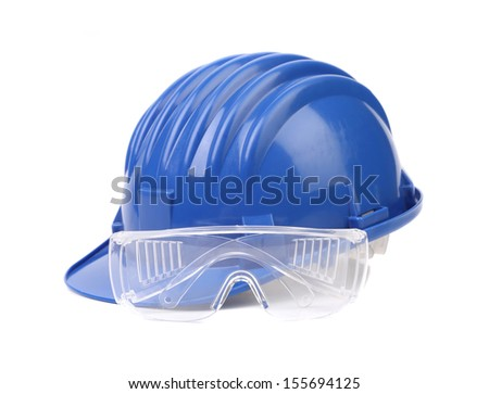 Blue hard hat with glasses. Isolated on white background. - stock photo