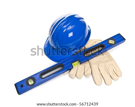 Blue hardhat with level and leather gloves isolated on white background - stock photo