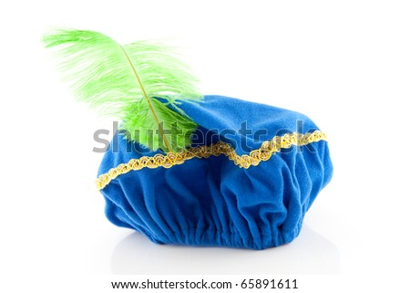 blue hat with green feather of Zwarte Piet, typical Dutch event in december, isolated on white background