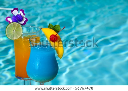 Blue Hawaiian and Mai Tai cocktails on swimming pool side - stock ...