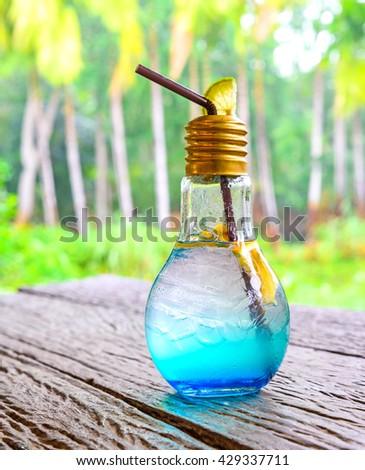 Blue Hawaiian cocktail on wood table. - stock photo