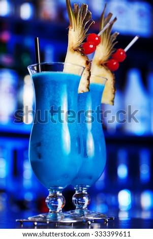 Blue Hawaiian cocktail shot on a bar counter - stock photo