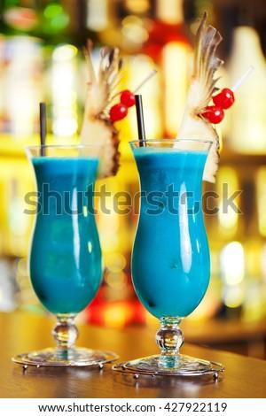 Blue Hawaiian cocktails on a bar counter - stock photo