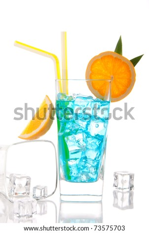 Blue hawaiian  lagoon curacao cocktail decorated with pineapple leaf, orange slice and cocktails straw and glass filled with ice isolated on a white background - stock photo