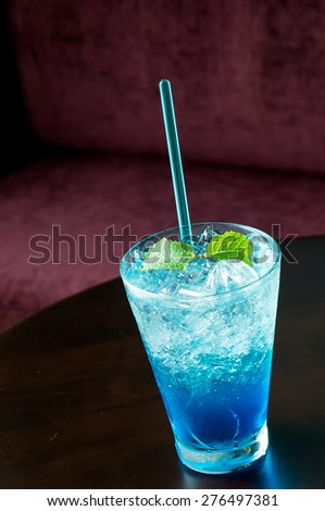 blue hawaiian soda with peppermint on top - stock photo