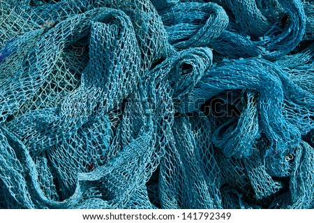 Blue Heap of Commercial Fishing Net. - stock photo