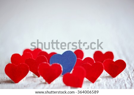 Blue heart and many red hearts on the white background. Valentines day. Concept Love. - stock photo