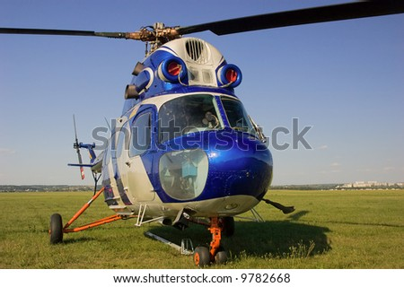 Blue helicopter on land - stock photo