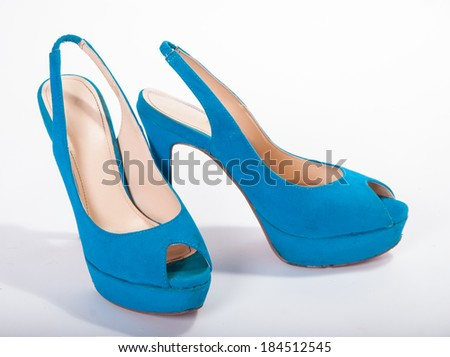 Blue high-heeled shoes on a white background