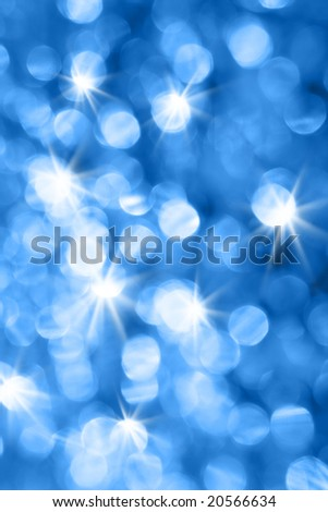 Blue holiday lights out of focus, may be used as background - stock photo