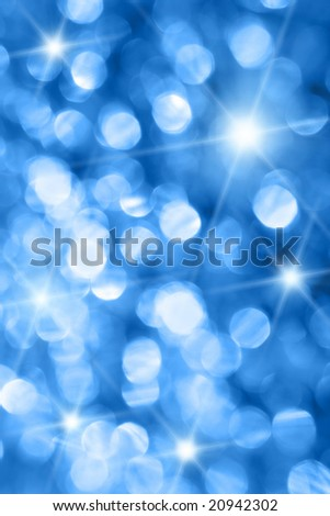 Blue holiday lights out of focus with stars - stock photo