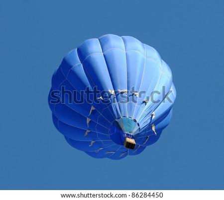 Blue hot air balloon against blue sky - stock photo