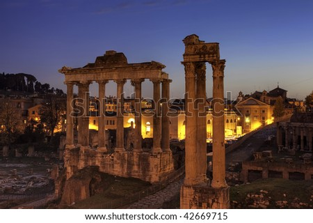Blue hour at the Forum Romanum with temple of Saturn and of Vespasian and Titus, Rome, Italy