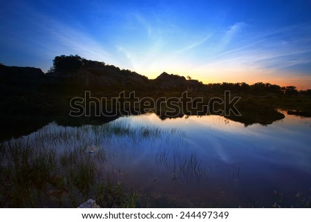 Blue hour during sunset with reflection scenery, Image has grain or noise and soft focus when view at full resolution(Shallow DOF, slight motion blur). - stock photo