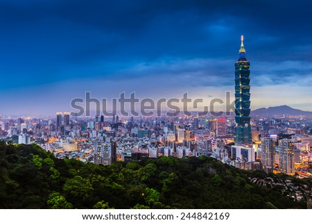 Blue hour night sky and illuminated city lighting of wide cityscape of Taipei, Taiwan/Taipei City View at Night - stock photo