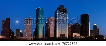 Blue Houston skyline with rising moon - stock photo