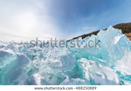 blue hummocks of of lake baikal ice in a stretched widescreen format