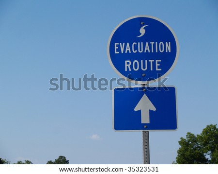 Blue hurricane evacuation route sign along a highway. - stock photo