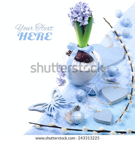 Blue hyacinth with Easter decorations on white background, corner element  - stock photo