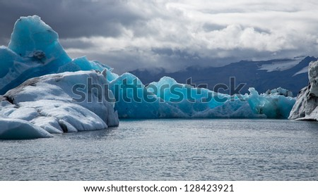 Blue ice at Jokulsarlon Iceland - stock photo