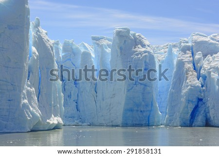 Blue Ice Columns of the Grey Glacier on the Water of Grey Lake in Torres del Paine in Patagonian Chile - stock photo