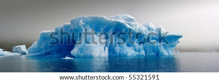 Blue ice in a dense fog - stock photo